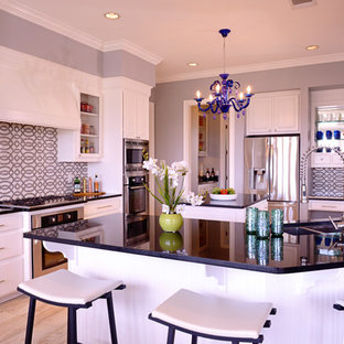 Contemporary kitchen remodeling - Trendy kitchen photo in Austin with a double-bowl sink, white cabinets and stainless steel appliances