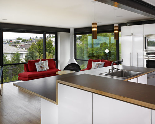 Example Of A Minimalist Open Concept Kitchen Design In Seattle With A  Drop In Sink