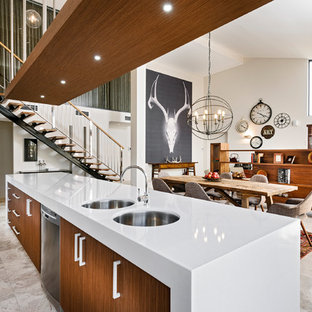 Eat-in kitchen - large contemporary galley travertine floor eat-in kitchen idea in Perth with stainless steel appliances, an undermount sink, quartz countertops, flat-panel cabinets, medium tone wood cabinets, an island, gray backsplash and glass sheet backsplash