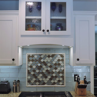 Inspiration for a mid-sized beach style galley eat-in kitchen in Other with a double-bowl sink, shaker cabinets, white cabinets, quartzite benchtops, blue splashback, glass tile splashback, stainless steel appliances, laminate floors, no island, multi-coloured floor and multi-coloured benchtop.