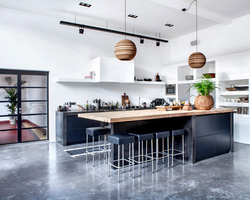 industrial kitchen photos urban concrete floor and gray floor kitchen photo in amsterdam with flat - Industrial Kitchen