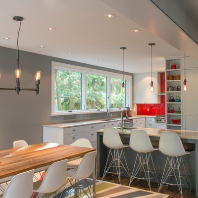 Eat-in kitchen - contemporary dark wood floor eat-in kitchen idea in DC Metro with an undermount sink, glass sheet backsplash, stainless steel appliances, an island, shaker cabinets, white cabinets and red backsplash