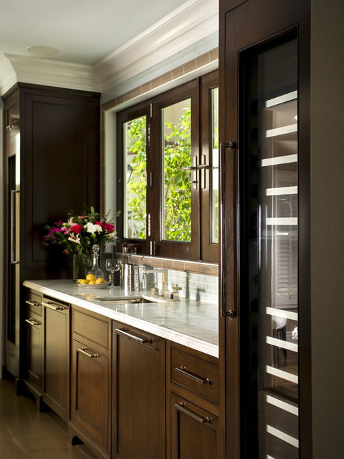Traditional Kitchen Idea In Los Angeles With Recessed Panel Cabinets And  Dark Wood Cabinets