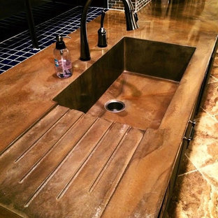 Design ideas for a mid-sized arts and crafts kitchen in Orlando with concrete benchtops and an integrated sink.