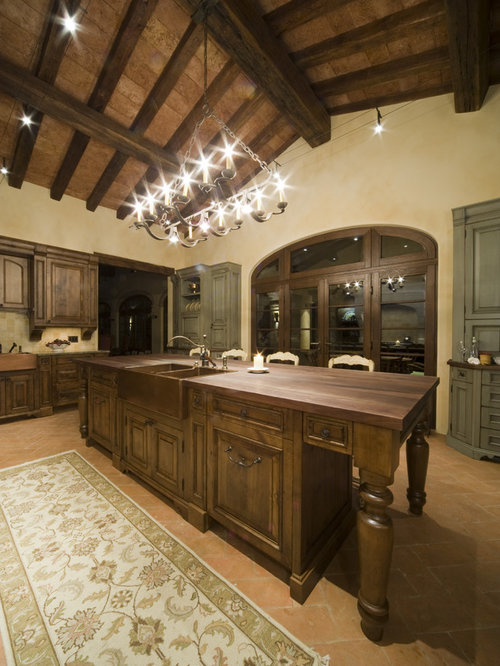 Example Of A Mountain Style Kitchen Design In Denver With Wood Countertops
