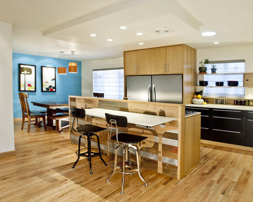 Trendy L Shaped Eat In Kitchen Photo In Denver With Stainless Steel  Appliances,