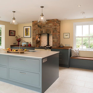 Photo of a mid-sized contemporary l-shaped open plan kitchen in Kent with flat-panel cabinets, grey cabinets, quartzite benchtops, porcelain floors, with island, beige floor, brown benchtop, an undermount sink and ceramic splashback.