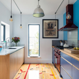 Small contemporary galley eat-in kitchen in Surrey with an integrated sink, flat-panel cabinets, medium wood cabinets, quartzite benchtops, grey splashback, coloured appliances, medium hardwood floors and multi-coloured floor.