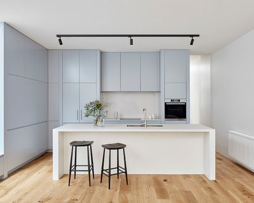 Inspiration For A Small Modern Galley Kitchen In Melbourne With A  Double Bowl Sink,