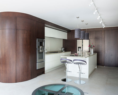 Example Of A Trendy Kitchen Design In London With Flat Panel Cabinets, Dark  Wood