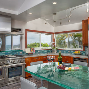 Inspiration for a large tropical eat-in kitchen in Hawaii with an undermount sink, shaker cabinets, medium wood cabinets, glass benchtops, multi-coloured splashback, glass tile splashback, stainless steel appliances, porcelain floors, no island and turquoise benchtop.