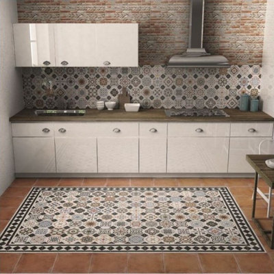 Mid-sized cottage chic ceramic tile eat-in kitchen photo in Other