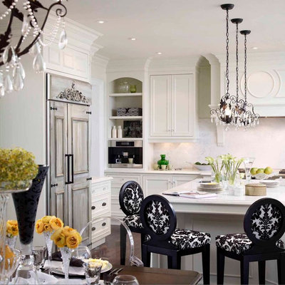Eat-in kitchen - mid-sized traditional l-shaped dark wood floor eat-in kitchen idea in Toronto with recessed-panel cabinets, white cabinets, paneled appliances, a farmhouse sink, quartz countertops, white backsplash, stone slab backsplash and an island
