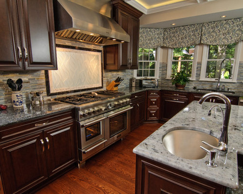 transitional kitchen idea in dc metro with a double bowl sink raised panel - Matchstick Tile Home Design