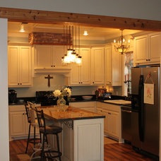 Farmhouse Kitchen by Acadian Builders