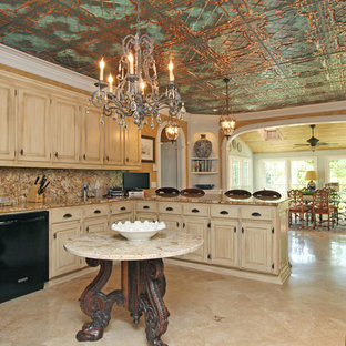 Mid-sized mediterranean eat-in kitchen ideas - Example of a mid-sized tuscan u-shaped travertine floor and beige floor eat-in kitchen design in Atlanta with an undermount sink, raised-panel cabinets, distressed cabinets, granite countertops, multicolored backsplash, stone slab backsplash, a peninsula and brown countertops