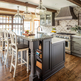 Traditional kitchen inspiration - Elegant galley brown floor and dark wood floor kitchen photo in Seattle with recessed-panel cabinets, gray cabinets, zinc countertops, multicolored backsplash, porcelain backsplash, stainless steel appliances, an island and gray countertops