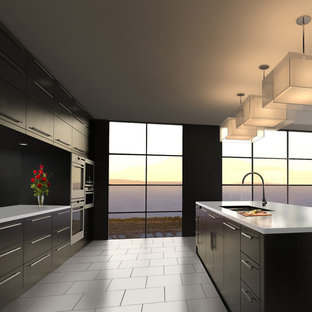 Example of a mid-sized minimalist galley ceramic floor and gray floor eat-in kitchen design in Austin with an undermount sink, flat-panel cabinets, black cabinets, solid surface countertops, black backsplash, stainless steel appliances and an island