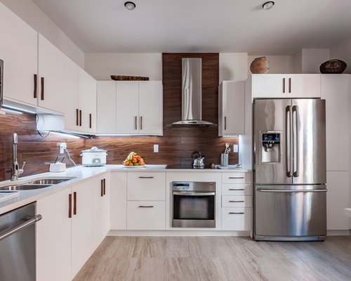 Kitchen with brown backsplash and an integrated sink for Stainless steel countertop with integral sink