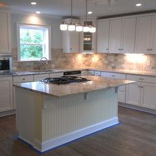 Beach Style Kitchen by Dimension Design & Construction, LLC.