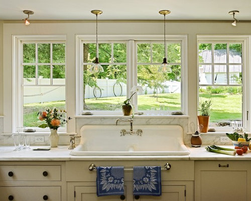 Traditional kitchen idea in Burlington with a drop-in sink, marble  countertops, white - Window Over Kitchen Sink Houzz