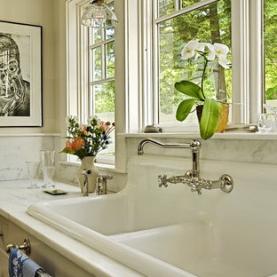 Example of a classic kitchen design in Burlington with a drop-in sink, marble countertops, white backsplash and stone slab backsplash