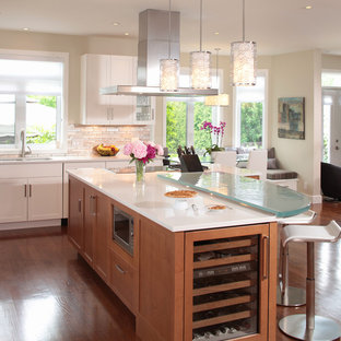 Contemporary kitchen designs - Inspiration for a contemporary kitchen remodel in Montreal with glass countertops