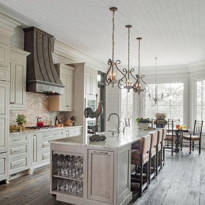 Kitchen - cottage galley dark wood floor and brown floor kitchen idea in Atlanta with a farmhouse sink, raised-panel cabinets, white cabinets, white backsplash, stainless steel appliances and an island