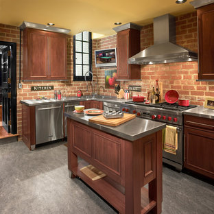 Small industrial kitchen pictures - Small urban l-shaped concrete floor kitchen photo in Cleveland with an integrated sink, recessed-panel cabinets, dark wood cabinets, stainless steel countertops, red backsplash, stainless steel appliances and an island