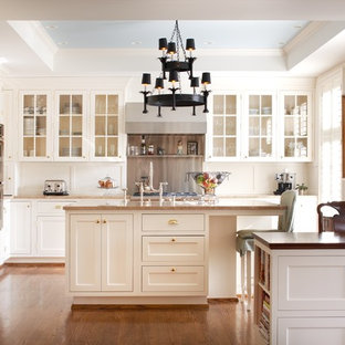 Example of a classic kitchen design in Louisville with glass-front cabinets, white cabinets and paneled appliances