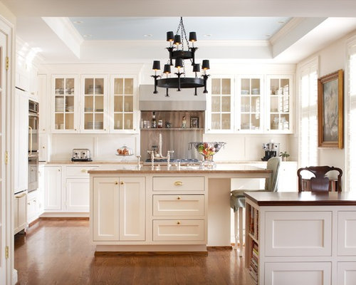 Example Of A Classic Kitchen Design In Louisville With Glass Front  Cabinets, White Cabinets