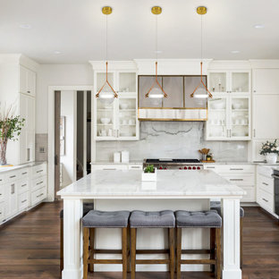 Mid-sized modern eat-in kitchen inspiration - Example of a mid-sized minimalist laminate floor and brown floor eat-in kitchen design in Miami with a farmhouse sink, glass-front cabinets, white cabinets, granite countertops, white backsplash, granite backsplash, stainless steel appliances, an island and white countertops