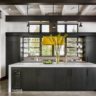 Mid-sized modern open concept kitchen ideas - Example of a mid-sized minimalist concrete floor and gray floor open concept kitchen design in Denver with flat-panel cabinets, black cabinets, quartz countertops, black appliances and an island