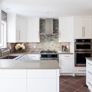 Design ideas for a mid-sized transitional u-shaped separate kitchen in DC Metro with an undermount sink, shaker cabinets, white cabinets, multi-coloured splashback, stainless steel appliances, a peninsula, multi-coloured floor, quartz benchtops, slate floors and marble splashback.