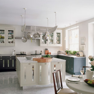 Eat-in kitchen - traditional l-shaped marble floor eat-in kitchen idea in London with an undermount sink, gray cabinets, marble countertops, stainless steel appliances and an island