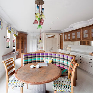 Photo of a bohemian l-shaped kitchen/diner in Other with shaker cabinets, medium wood cabinets, white splashback and an island.