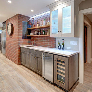 Inspiration for a large midcentury u-shaped eat-in kitchen in Dallas with an undermount sink, beaded inset cabinets, distressed cabinets, quartz benchtops, white splashback, ceramic splashback, stainless steel appliances, painted wood floors and with island.