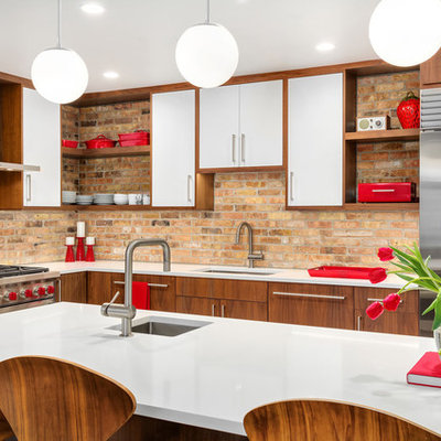 Inspiration for a 1950s l-shaped kitchen remodel in Chicago with an undermount sink, flat-panel cabinets, dark wood cabinets, brown backsplash, brick backsplash, stainless steel appliances, an island, white countertops and quartz countertops