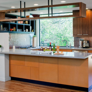 Kitchen - contemporary u-shaped kitchen idea in Austin with an undermount sink, flat-panel cabinets, medium tone wood cabinets, brown backsplash, mosaic tile backsplash and stainless steel appliances