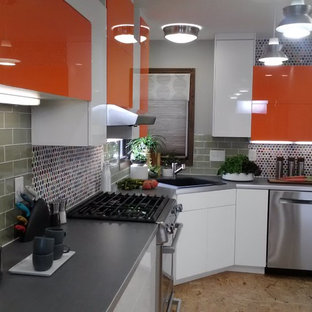 Design ideas for a medium sized eclectic galley kitchen/diner in Minneapolis with a single-bowl sink, flat-panel cabinets, orange cabinets, laminate countertops, green splashback, metro tiled splashback, stainless steel appliances, plywood flooring and no island.