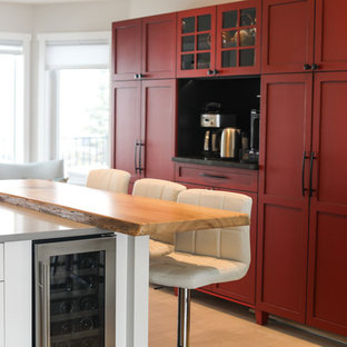 Medium sized traditional l-shaped kitchen pantry in Calgary with a submerged sink, shaker cabinets, white cabinets, quartz worktops, white splashback, ceramic splashback, stainless steel appliances, porcelain flooring, an island and grey floors.