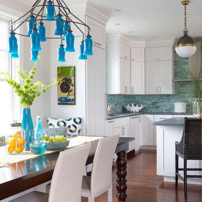 Example of a beach style u-shaped medium tone wood floor eat-in kitchen design in Boston with shaker cabinets, white cabinets, blue backsplash and an island