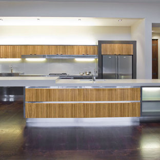 Example of a large trendy galley dark wood floor open concept kitchen design in Los Angeles with flat-panel cabinets, an island, an undermount sink, white backsplash, glass sheet backsplash and stainless steel appliances