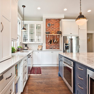 Large farmhouse open concept kitchen ideas - Large farmhouse l-shaped medium tone wood floor open concept kitchen photo in Nashville with a double-bowl sink, recessed-panel cabinets, white cabinets, marble countertops, white backsplash, subway tile backsplash, stainless steel appliances and an island