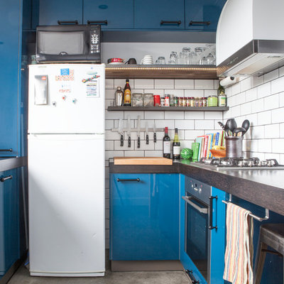Inspiration for a contemporary enclosed kitchen remodel in Melbourne with open cabinets, white appliances, wood countertops, white backsplash, subway tile backsplash and blue cabinets