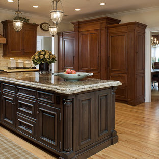 Inspiration for a large traditional separate kitchen in New York with with island, recessed-panel cabinets, brown cabinets and light hardwood floors.