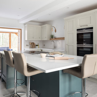 Medium sized traditional l-shaped enclosed kitchen in Other with shaker cabinets, quartz worktops, white splashback, stone slab splashback, integrated appliances, an island, grey floors, white worktops and beige cabinets.