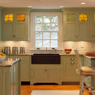 Beach style kitchen in Boston with subway tile splashback, a farmhouse sink, green cabinets, white splashback and beaded inset cabinets.