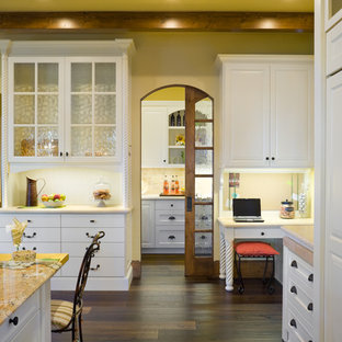 Design ideas for a large traditional open plan kitchen in Portland with raised-panel cabinets, white cabinets, with island, granite benchtops, beige splashback, stone tile splashback, stainless steel appliances, dark hardwood floors, brown floor and beige benchtop.