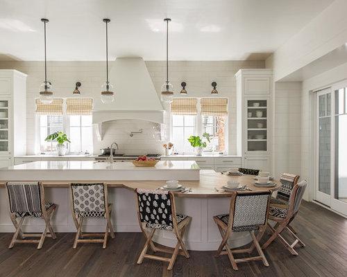 Example Of A Coastal L Shaped Dark Wood Floor And Brown Floor Eat In